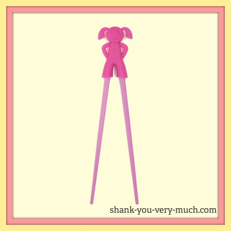 A picture of a rubber girl with two chopsticks for legs. The rubber girl allows the chopsticks to open and close.