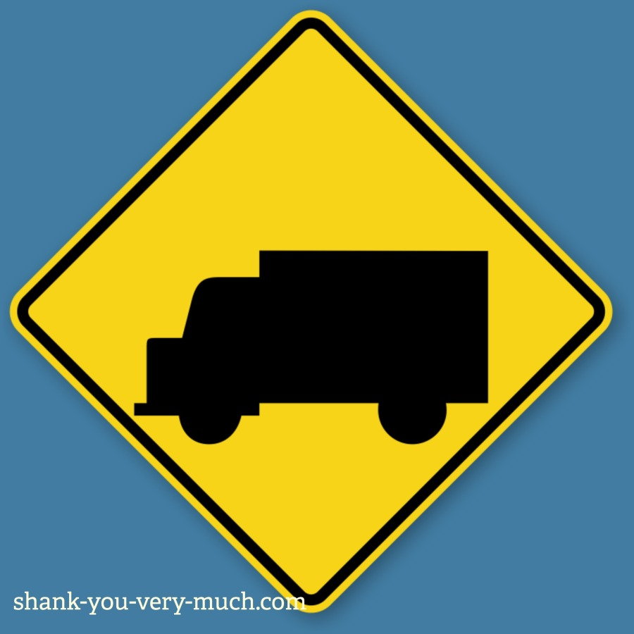 A street sign showing a truck