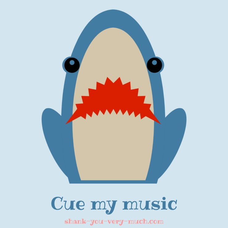 A cartoon shark who has his front half of the body out of the water and looking at you with his mouth open and the phrase 'cue my music' underneath him.